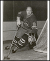 Bobby Hull skating behind the net with the puck