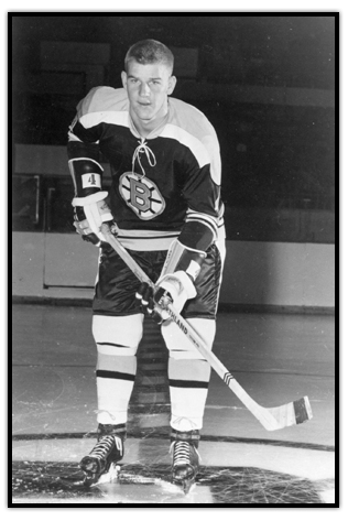 Bobby Orr posing on the ice with his stick