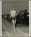 Bruce Kidd at the end of a race