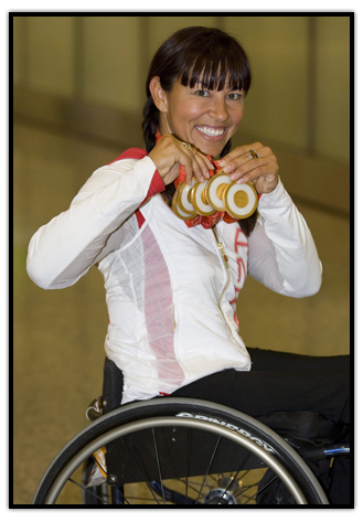 Chantal Petitclerc shows off her five Gold medals