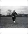Fritz Hanson on the football field carrying the football
