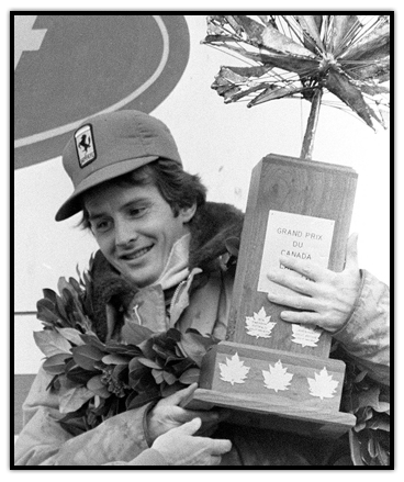 Gilles Villeneuve holding a trophy for winning the Canadian Grand Prix
