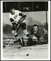 Gordie Howe (left) with goaltender Johnny Bower on the ice