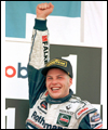 Jacques Villeneuve celebrates Formula One World Championship