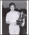 Jocelyne Bourassa  with a golf trophy