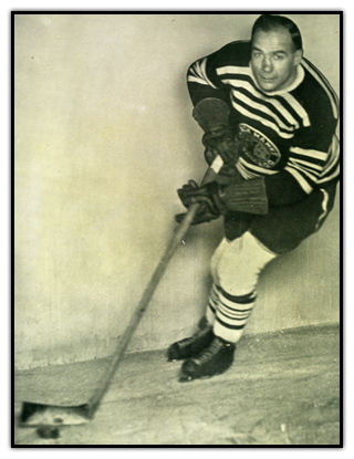 Lionel Conacher stickhandling the puck with the Chicago Black Hawks