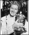 Marlene Streit posing with a trophy