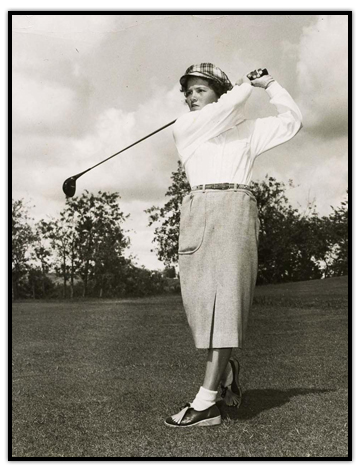 Marlene Streit  swinging a golf club