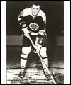 Phil Esposito in his Boston Bruins uniform holding his stick