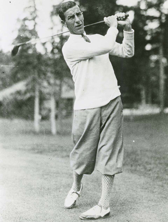 Charles (Sandy) Somerville stands on the golf course with his club
