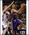 Steve Nash with the basketball while being defended by Matt Bonner of the Toronto Raptors
