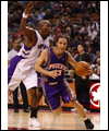 Steve Nash dribbles past Eric Williams