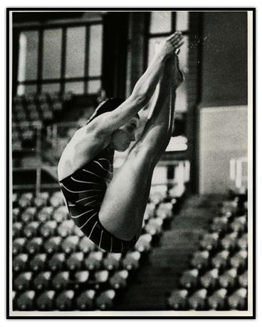 Sylvie Bernier touching her toes while diving